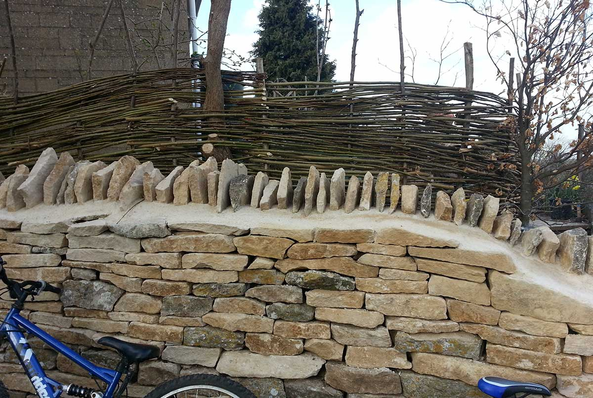 Cotswold stone wall and Willow screen - Ayurvedic Permaculture Garden Design, Finstock, Oxfordshire - Gaiaveda Gardens